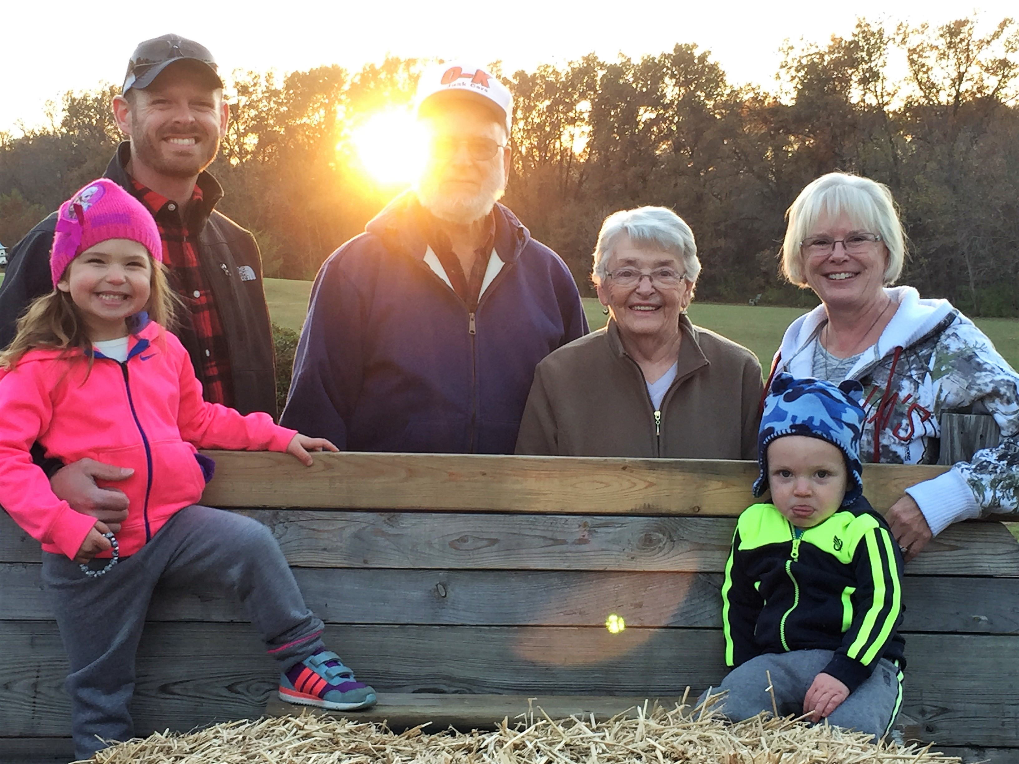 Family hayride to pick pears. Grandparents are special.
